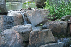 Water flowing over large stones Royalty Free Stock Photos