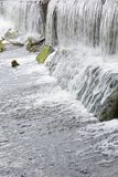 Water flowing over rocks. Royalty Free Stock Photo