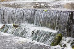Water flowing over rocks. Stock Photo