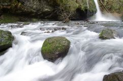 Water flowing over rocks Stock Photography