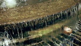Water flowing over rocks stock video footage