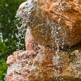 Water flowing over rocks closeup Royalty Free Stock Image