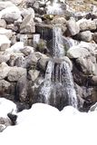 Water flowing over rocks depicting a waterfall royalty free stock images