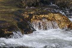 Water Flowing over Rocks Royalty Free Stock Photos