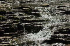 Water flowing over rocks Stock Image