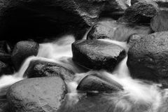 Water flowing. Over rocks in stream Stock Photo