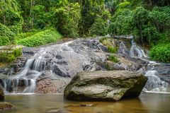 Water Flowing Over Rocky Slope. Tropical Waterfall in Thailand.  stock image