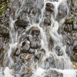 Water flowing over stones Royalty Free Stock Images