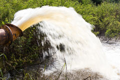 Water flowing from pipe. Stock Photo