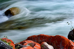 Water flowing with red rocks Royalty Free Stock Photo