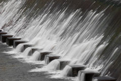 Water flowing from reservoir sluice Royalty Free Stock Photography