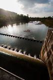 Water flowing from reservoir sluice Royalty Free Stock Photos