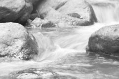 Water flowing on the rock and wave splashing in river. Water flowing on the rock and wave splashing in the river stock photos