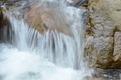 Water flowing on the rock and wave splashing in river. Water flowing on the rock and wave splashing in the river royalty free stock photos