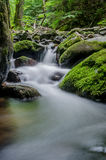 Water flowing through rocks Royalty Free Stock Images
