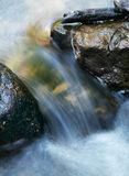 Water Flowing And Rushing Between Rocks stock images