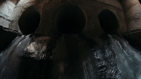 Water flowing through the sewerage. Water flowing through the sewers pipe stock footage