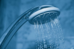 Water flowing from shower Stock Photo