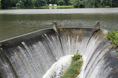 Water flowing from spillway Stock Photo