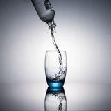 Water flowing and splashing into a glass Royalty Free Stock Photos