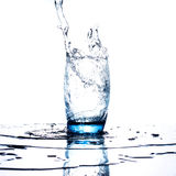 Water flowing and splashing into a glass Stock Image