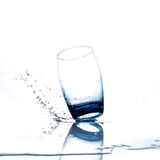 Water flowing and splashing into a glass Stock Photography