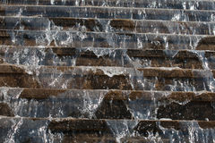 Water flowing from steps of the stairs Royalty Free Stock Photos