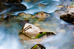 Water flowing on the stones. Stones and flowing water, Calore River, Cilento and Vallo di Diano National Park, Italy royalty free stock photography