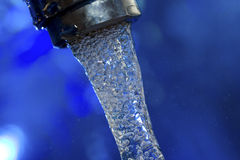 Water flowing from the tap Royalty Free Stock Photos