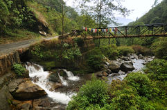 Water flowing under bridge, Kukhola falls, Sikkim Stock Images