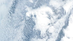 Water flowing under transparent ice surface. Ice background. Ice pattern stock video footage