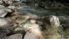 Water Flowing from Waterfall Rushing down the Creek with Rocks and Boulders including Audio Sound 1080p stock video