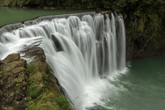 Water flowing at a waterfall in Taiwan Stock Photo
