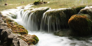 Water flows. On rocks, stream with small waterfall Royalty Free Stock Image