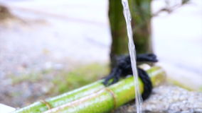 Water Flows From Bamboo Pipe In Japan. Water Flows From natural Bamboo Pipe In Japan stock footage