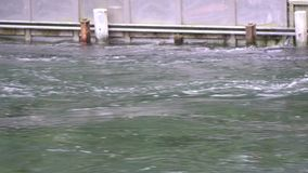 Water flows through the water barrier, a splash of freshness, a calm scene suitable for meditation.  stock video footage