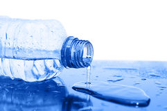 Water flows from a bottle. Close up stock image
