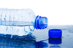 Water flows from a bottle. Still life royalty free stock photo