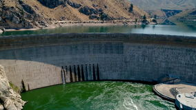 Water flows from an dam in Idaho to help lower the reservoir stock footage