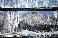 Water fountain with cascade and backlight. Water flows down the cascade waterfall Stock Images