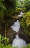 Devi`s Falls in Pokhara, Nepal. Water flows down Devi`s Falls into the Gupteshwar Cave below in Pokhara, Nepal Stock Photography