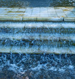 Water flows down marble steps Stock Photo