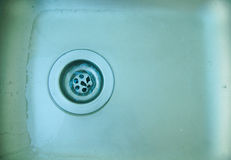 Water flows down the pipes sink. royalty free stock photography