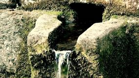 Water Flows Down Of Stone in Memorial Fountain. This is footage of Water Flows Down Of Stone in Memorial Fountain stock footage