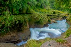 Water flows downstream to Devi`s Falls in Pokhara, Nepal Royalty Free Stock Image