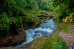 Water flows downstream to Devi`s Falls in Pokhara, Nepal Stock Photos