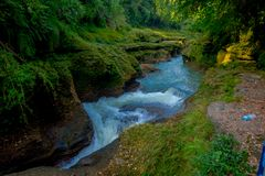 Water flows downstream to Devi`s Falls in Pokhara, Nepal Royalty Free Stock Photo