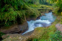Water flows downstream to Devi`s Falls in Pokhara, Nepal Royalty Free Stock Photography