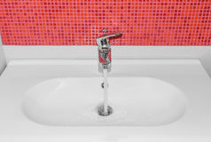 The water flows from faucet. Royalty Free Stock Images