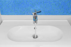 The water flows from faucet. Royalty Free Stock Image